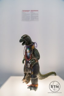 A godzilla toy draped in jewlery at the Museum of Broken Relationships in Zagreb, Croatia