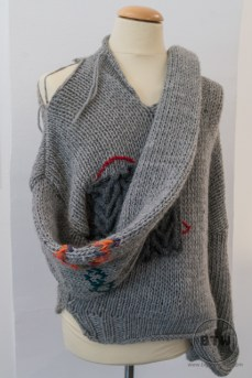 A tattered sweater at the Museum of Broken Relationships in Zagreb, Croatia