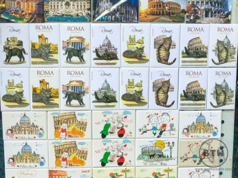 Souvenir magnets at the Roman Colosseum, including ones featuring cats