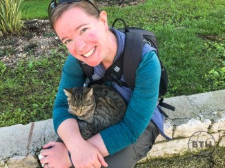 Brianna with a tabby curled up in her lap in Trogir, Croatia