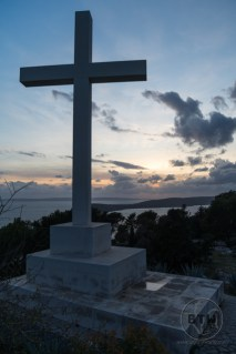 A cross in front of a setting sun atop the western hill in Split, Croatia