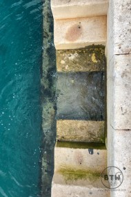 Steps leading down into the water in Split, Croatia