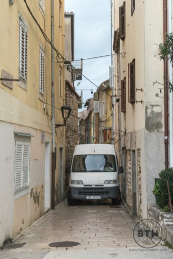 A van squeezed into a narrow alley in Zadar, Croatia