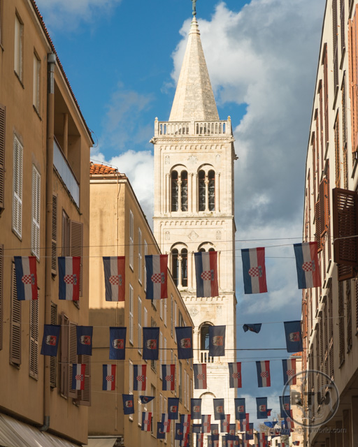The Bell Tower in Zadar, Croatia, with Croatian flags in the foreground