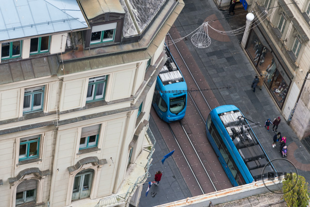 Trains passing on the street below the Zagreb 360 building in Zagreb, Croatia