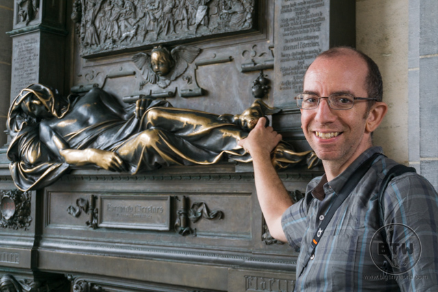 Aaron touching a statue in Brussels, Belgium
