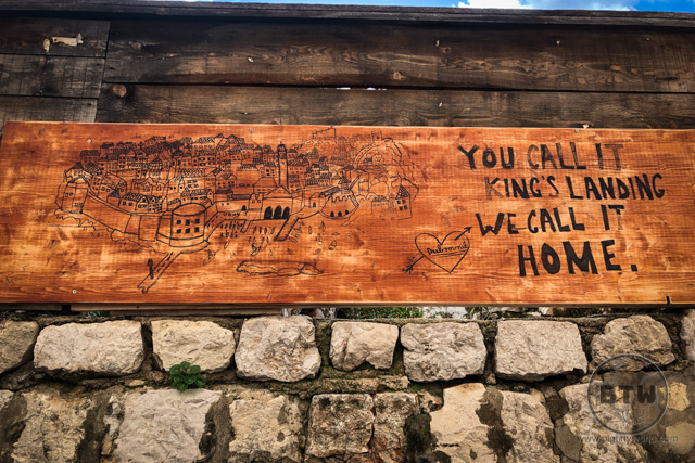 "A sign in Dubrovnik, Croatia, that reads, ""You call it King's Landing; We call it home."""