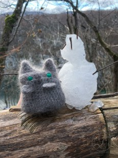 The Holee travel kitty next to a mini ice snowman in Plitvice Lakes National Park, Croatia