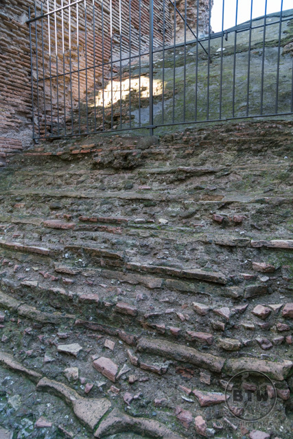 A worn stone staircase in the Colosseum in Rome, Italy