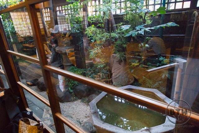 Looking through the glass windows to the zen garden at the Komakata Dozeu restaurant in Asakusa, Tokyo, Japan | BIG tiny World Travel