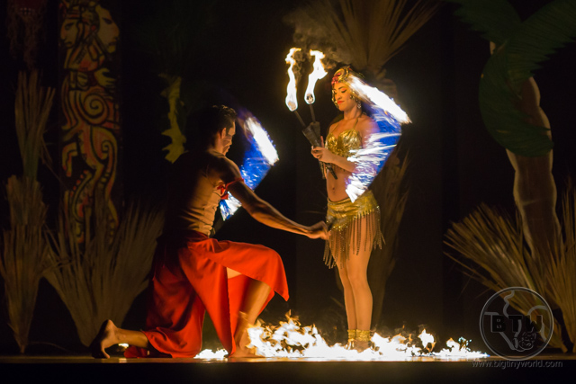 A man swinging fire on ropes to either side of a woman standing on stage during an evening show at the Doubletree Resort in Puntarenas, Costa Rica | BIG tiny World Travel