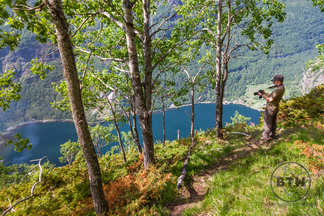 Aaron taking a picture of the Geiranger Fjord from the Losta Trail in Norway | BIG tiny World Travel