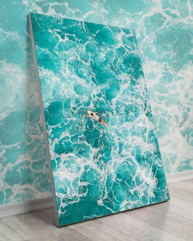 oversized ocean wall decor with a solo surfer