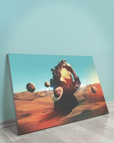 Oversized lady in the desert with planets orbiting around her head wall decor