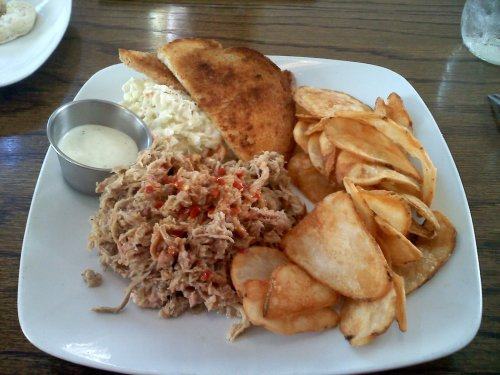 BBQ pork plate with slaw and homemade chips
