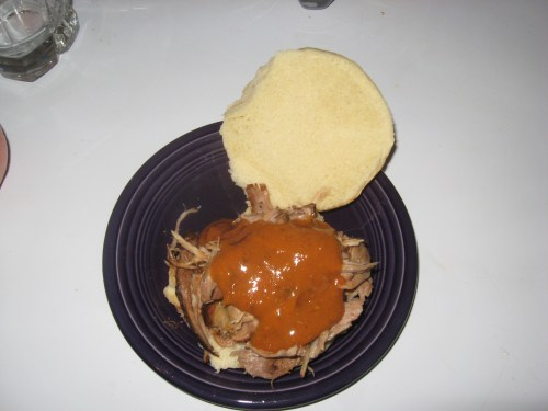 Mustard grilling sauce on a pulled pork sandwich