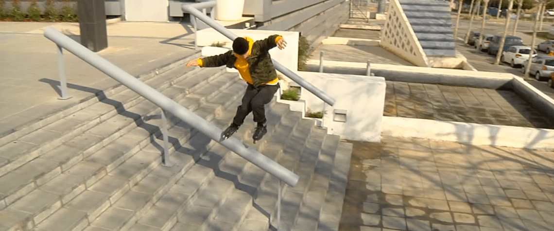 Alex Broskow doing a pudslide on a hand rail