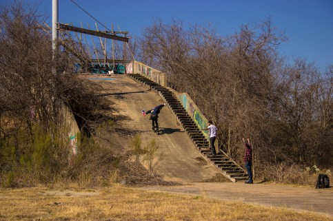 Caleb Smith with a fakie roll into the ramp of mystery. Photo by Joseph Gammill.