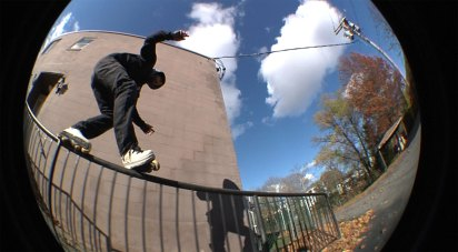 Rob pulling a top acid on the hand rail.