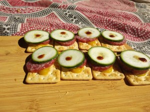 Sad looking crackers with toppings
