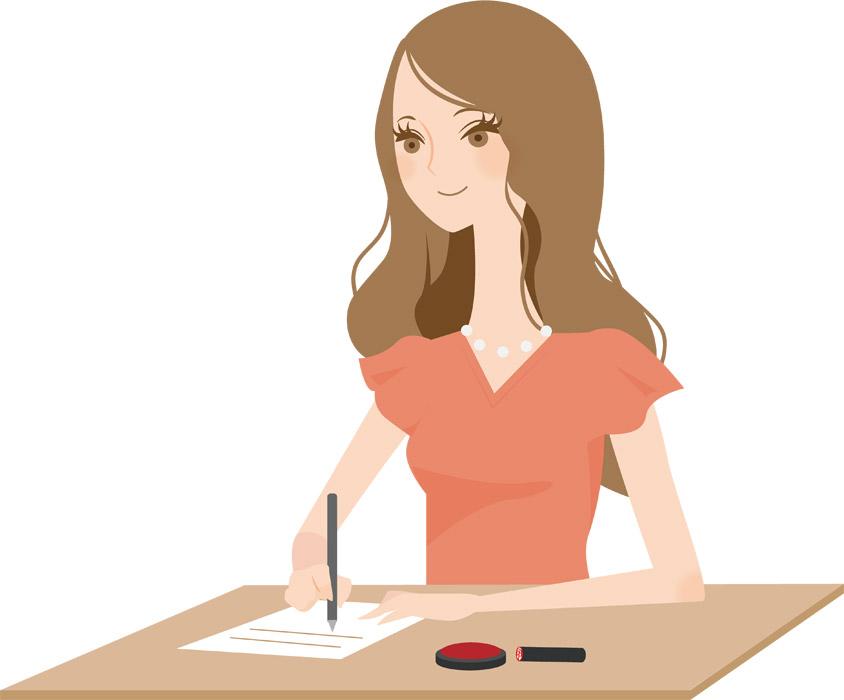 契約書に記入する女性