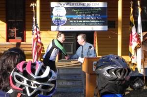 Chief Davis and BikeAAA's  Jon Korin at Lifeline100 Announcement
