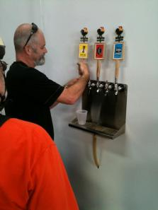 John, the brewmaster at Four Corners, on the pour