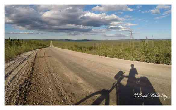 Cycling across the plateau near Eagle Plains on the Dempster Hwy