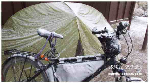Snow on the bike and tent the next morning