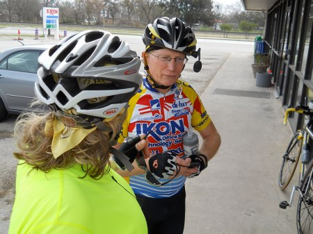 At the Buda rest stop, Maggie and Jim talk about their gym workouts .