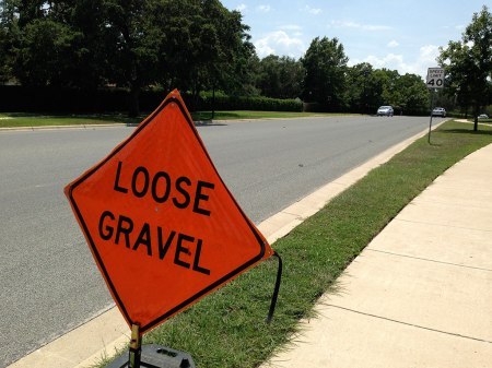 Uh oh. Bad news for bikers. Those little things sticking up in the road mark where the road will be striped, once the surface flattens out.