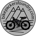 Bikepackers Foundry logo. Mountains and bicycle.