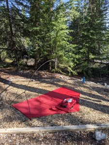 DIY footprint with the poles installed into the corner rings. If it's windy rocks or other heavy objects can hold the footprint down while the fly is installed. If the footprint is wet or snow covered, just give it a shake after the fly is installed and before adding the tent body.