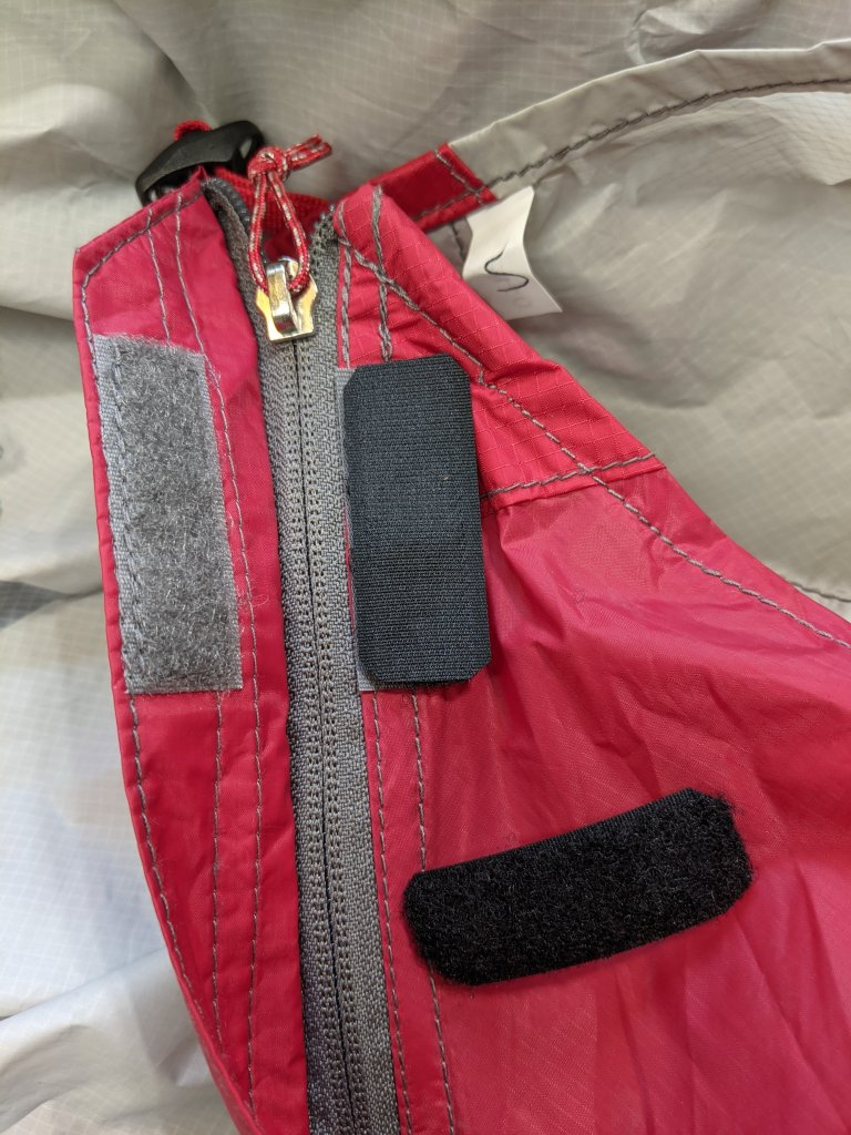 """Two short lengths of 3/4"""" Loop Velcro have been cut to cover the matching Hock segment on the tent fly.  one is shown installed with the second one loose beside it."""