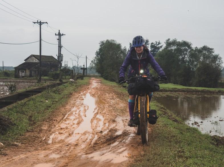 Muddy ride among rice fields