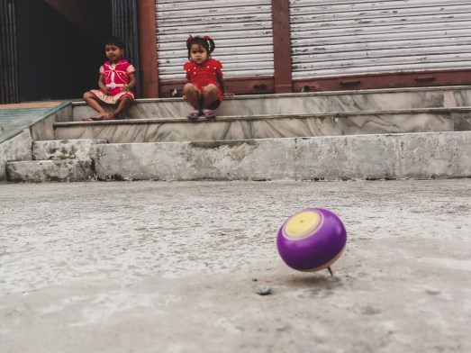 Kids and a spinner toy. Pokhara, Nepal