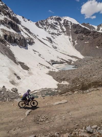 Rocks, snow and ponds. Tosor Pass, Kyrgyzstan