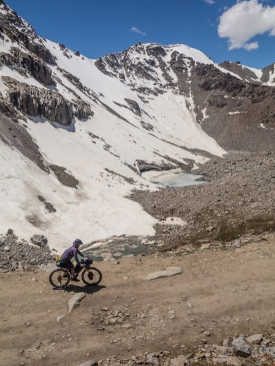 Rocks, snow and ponds. Tosor Pass, Kyrgyzstan