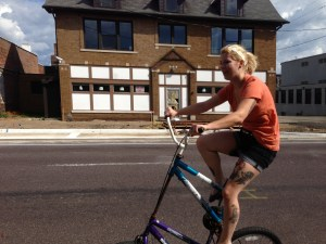 Michelle is doing it right on a tall bike!