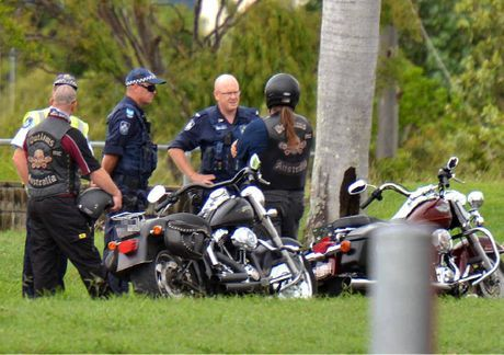 Mackay police officers chat to two motorcyclists on Harbour Rd just after a funeral was held.