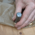 "3. Next use the grommet tool to insert two grommets on each 108"" side, about 18"" from the front and back (the video below shows how to use a grommet tool). If you are using thin cloth, reinforce it first with an iron-on patch."