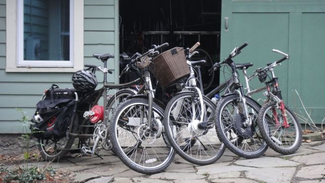 From left to right my bike, my wife's bike, Thea's bike, and JJ's bike in front of our bike stable.