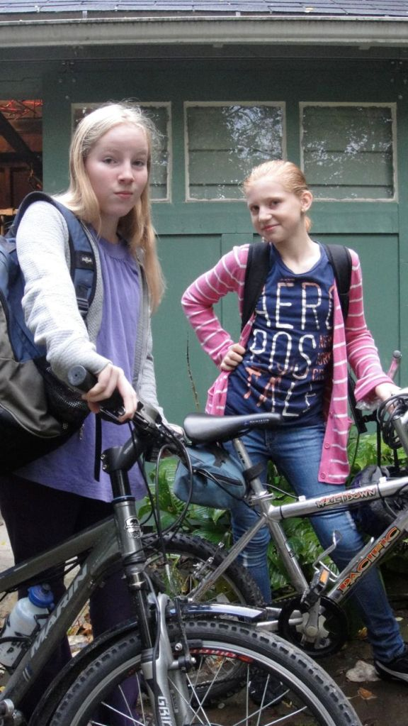 Thea (left) and our neighbor JJ (right) used to walk a few blocks to elementary school but this fall they started at a middle school about 2 miles away. They were discouraged to find that the school bus takes 45 hot and stuffy minutes to get to school. The city bus only takes 15 minutes but costs $.75 and requires a 10-minute walk downtown. Biking, on the other hand, only takes 10 minutes! Thea already had an electric bike, and we equipped JJ's bike with a motor too so she could keep up. I escorted them for the first few months and helped them work out a safe route.