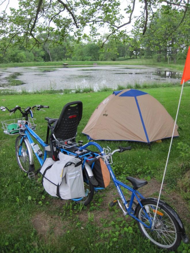 electric cargo bike camping - farm pond camp site