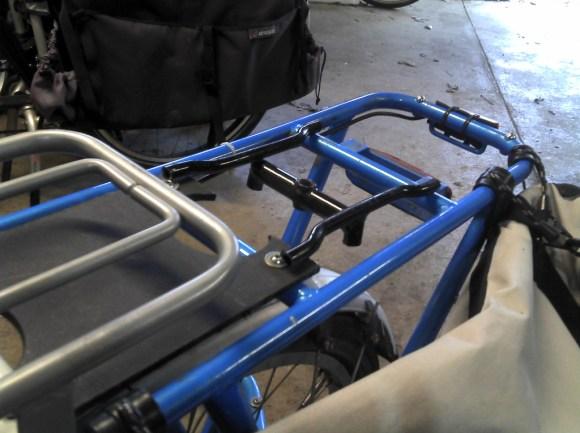 mockup of custom welded mount for a Burley piccolo on a Yuba Mundo