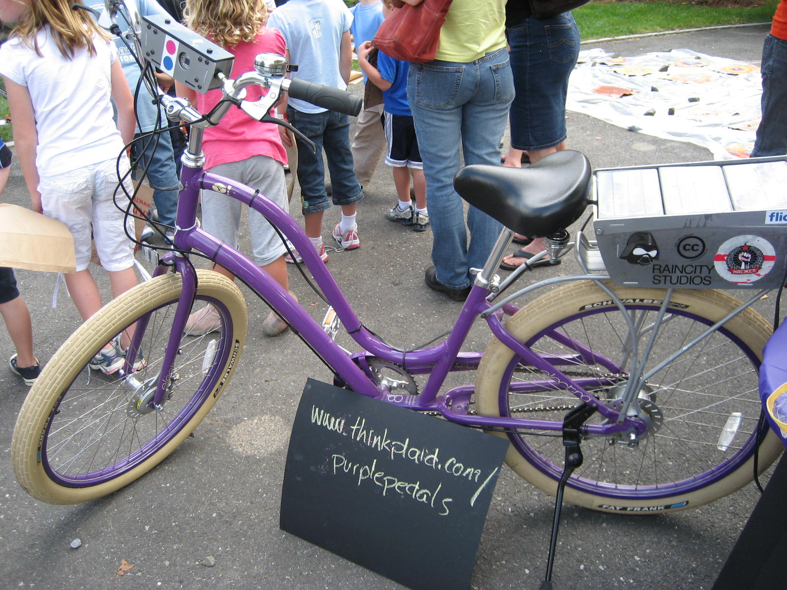 Purple Pedal project bike with solar powered camera (on handlebars)
