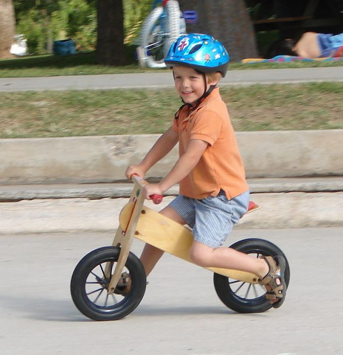 kid on a balance bike