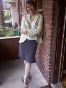 A typical outfit for riding my bike--which most people would never realize. That's my point. (White woman on porch wearing dark gray skirt, white blouse, light green jacket, green sandals)