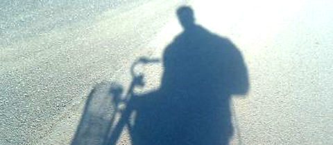 Shadow photo of Andrea on her bike. Picture b Andrea Parrish.