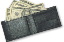 A wallet full of cash showing $20 bills sticking out